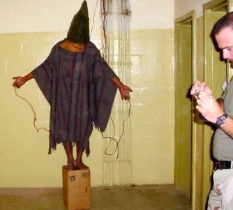 "By far the most famous photo that emerged from Abu Ghraib, the detainee seen here is being tortured through a tactic which originated in Brazil known as ""the Vietnam."" According to a documentary which aired on HBO, ""Ghosts of Abu Ghraib"", the fact that these tactics were used is noteworthy because it demonstrates these weren't just ""a few bad apples"" of the U.S. military who ""went rouge"" for lack of a better term. They were obviously trained in these tactics."