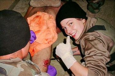 Spc. Lynndie England apparently taking honor in the barbarity that his just occured.