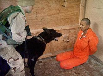 "Two of the military's ""dog trainers"" said that military intelligence had ordered the use of dogs as a means of interrogation (i.e. torture tactic)."