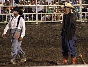 A rodeo clown by the name of Terry Gessling (right) dawns a mask intended to be a caricature of President Barack Obama.