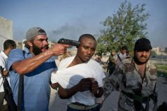 Libyan rebels who were backed by NATO rounded up Black people residing in Tripoli - beating, torturing and lynching them in broad daylight.
