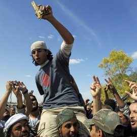 Anti-Gaddafi rebels celebrate after sacking Gaddafi's hometown of Sirte, Libya.