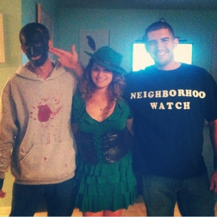 To the left is Florida car-thief William Filene donning blackface obviously meant to resemble the burnt cork used by white actors to mock and stereotype Black people during the 19th and 20th centuries. The blood-stained hoodie is meant to represent him being Trayvon Martin. In the middle is Caitlin Cimeno doing her best impersonation of a hooker. And on the right is Greg Cimeno doing a very good impression of white supremacist George Zimmerman with his fingers held in the shape of a gun to look as if he is reenacting the killing of Trayvon Martin.
