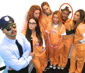 "D-list celebrity Julianne Hough and her friends are dressed as the cast from a Netflix flick called ""Orange is the New Black"". Hough is supposed to be imitating an African American character known as ""Crazy Eyes."" See if you can spot her."
