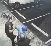 Here a customer is arrested simply for riding a bicycle, caught on one of the 15 surveillance cameras store owner Alex Saleh installed to document police abuse and racial profiling.