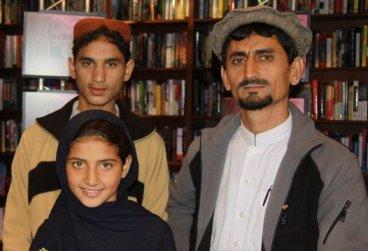 Zubair Rehman, his father (a school teacher) Rafiq ur Rehman, and little sister Nabila Rehman on set for an interview on 'Democracy Now' with Amy Goodman