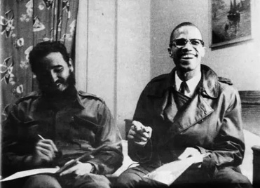 Cuba's Revolutionary Leader (on left) seated with one of America's great Revolutionaries, Malcolm X.