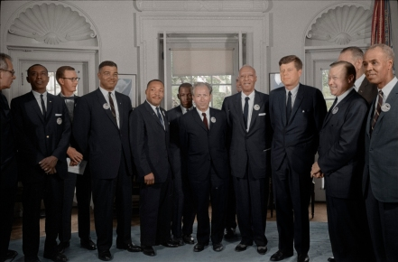 pictured third from left is Whitney Young, Martin Luther King Jr., standing behind King is John Lewis. Standing to the right of President John F. Kennedy is the legendary A. Philip Randolph, and to the furthest right in the photo is Roy Wilkins of the NAACP. This photograph was taken after the March on Washington in 1963.