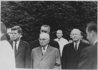 Presidents JFK, Harry Truman, and Dwight D. Eisenhower with Vice President Lyndon B. Johnson behind Truman.
