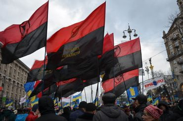These red-and-black flags were seen frequently flying during the Maindan protests. They are flown in honor of the Organization of Ukrainian Nationalists, a group of militants in the mid-20th century led by Stepan Bandera which fought alongside the Nazis to invade the Soviet Union.