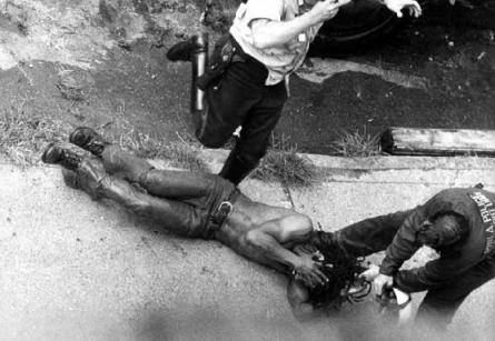 a scene from the brutally racist attack on MOVE headquarters by Philadelphia police in the 1970's.