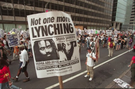 "scene from a ""Free Mumia"" political rally in 2000."