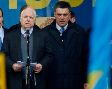 Senator John McCain (AZ) shares the stage with neo-Nazi founder Oleg Tyhanbock in Kiev.