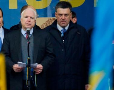 Senator John McCain (AZ) shares the stage with neo-Nazi founder Oleg Tyhanbock in Kiev.