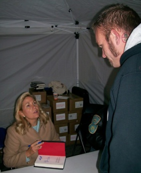 Maureen Faulkner autographs a copy of her book for a neo-Nazi.
