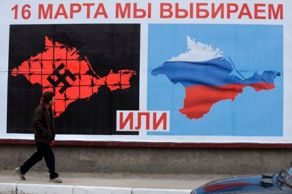Voters in the Crimea went to the polls on March 16, 2014 to decide on whether they wished to remain a part of the Ukraine or not. This billboard attempts to persuade voters to vote for succession by showing Ukraine under Nazi control as opposed to Ukraine under as a part of the larger Russian Federation.