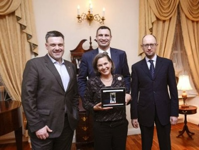Assistant Secretary of the U.S. Victoria Nuland in Ukraine smiles with known right-wing fascist and neo-Nazi Oleh Tyahnybok to her right, the new Western puppet P.M. Arseniy Yatsenyuk to her left, and professional boxer  Vitali Klitschko behind her.