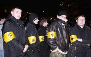Members of fascist neo-Nazi groups such as Svoboda and Right Sector were a driving force in bringing new leadership to the Kiev government. Here Ukrainian youth wear arm-patches with the social-nationalist party's take on the swastika as originally worn by members of the S.S. in Nazi Germany.