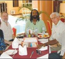"""Pink Swastika"" author (left), ""ex-gay"" person Caleb Lee (center), and Exodus International spokesperson Don Schmierer smiling for the camera at a Ugandan hotel resort."