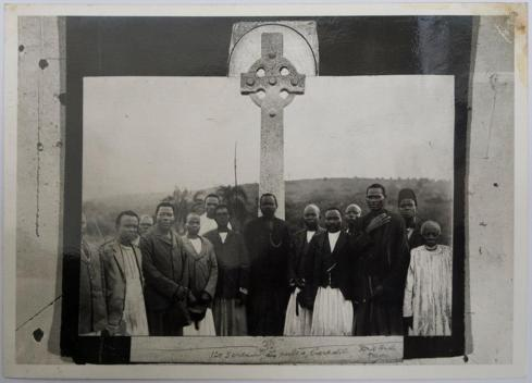 Christian converts gather around the memorial erected in honor of the Bugandan 'Martyrs'.