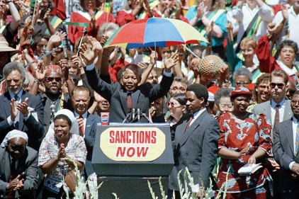 "Nelson Mandela on his visit to Oakland, California in 1990; ""Sanctions NOW"" campaign"