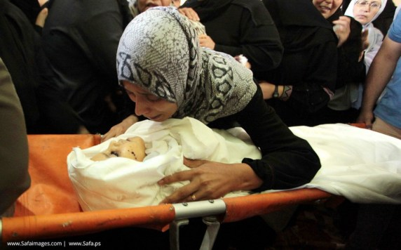 Grieving mother and child