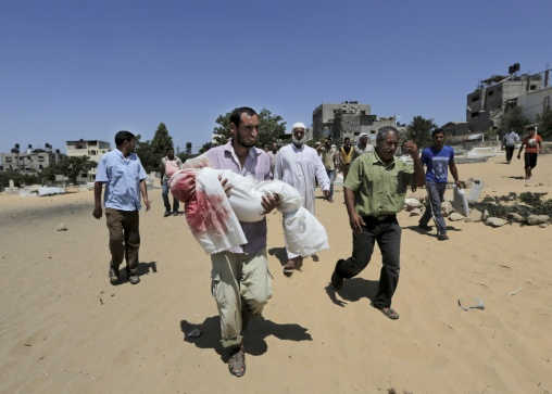 4 year old Abdallah Ghazal carried by his father