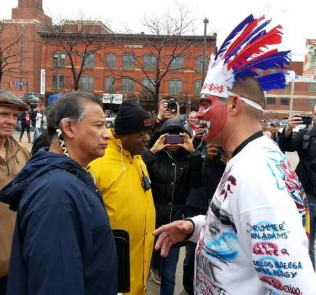 The awkward moment when Robert Roche of the American Indian Movement (left) is confronted by Pedro Rodriguez (right), who is donning redface, outside a Cleveland Indians game.