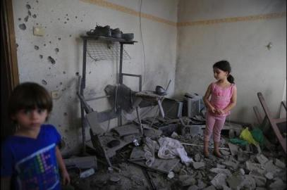 refugee children in Gaza whose house was destroyed by Israel