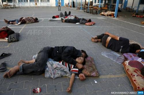 sleeping outside the UN refugee schools, which are overcrowding