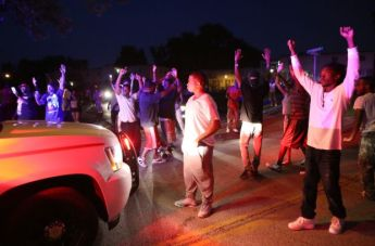 """""""Don't shoot me!"""" say protesters of Ferguson community to police officers."""
