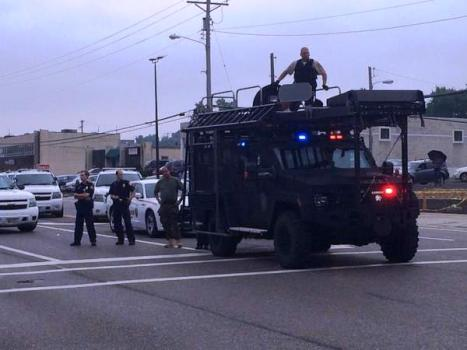 Up to 60 police units arrive in military SWAT vehicles, responding to a perceived threat from 100 peaceful protesters outraged at the police murder of 18 year-old Michael Brown