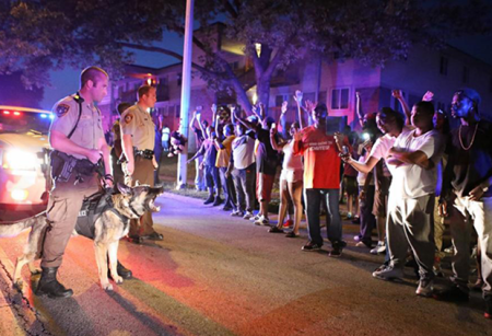 """On the very night following the execution of Mike Brown by a still-unnamed police officer, before any of the so-called """"rioting"""" had ever begun, police responded to demonstrators by bringing out military equipment, assault rifles and vicious canines in an attempt to intimidate dissenters."""
