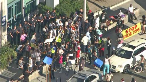 People demand an end to extrajudicial executions by the police in front of Los Angeles Police Department.