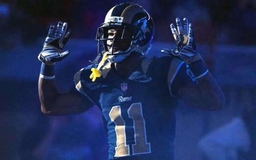 "Tavon Austin of the St. Louis Rams holds his hands up to signify ""Hands Up, Don't Shoot"" in solidarity with people around the world protesting against police brutality  and for better accountability."