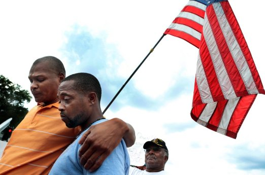 Mike Brown's Stepfather Louis Head with cousin Eric Davis at a memorial rally