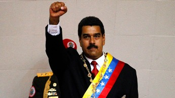 "Venezuelan President Nicholas Maduro vowed to resist U.S.-imposed sanctions, saying of the U.S. Congress, ""They can shove their US visas where should be shoved, insolent Yankees!"""