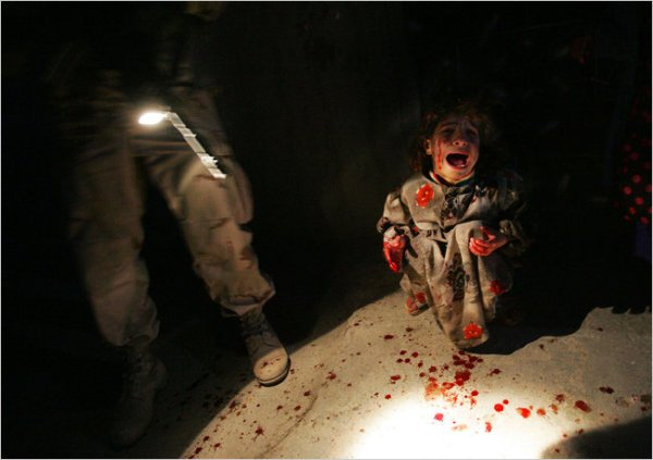 Photographer Chris Hondros famously photographed the moment when young Samar Hassan is seen screaming after her parents were slaughtered by U.S. soldiers in Iraq in 2005.