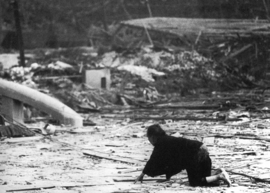 An elderly woman is lost amidst the chaos in the aftermath of the nuking of Nagasaki.