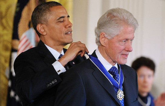 President Barack Obama honors former President Bill Clinton the medal of freedom at a White House ceremony in November, 2013.