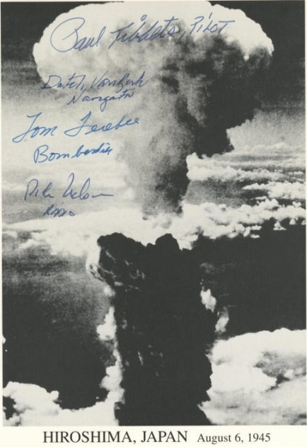A picture showing the mushroom cloud from the atomic bomb's impact on Nagasaki, proudly autographed by Enola Gay crew members.