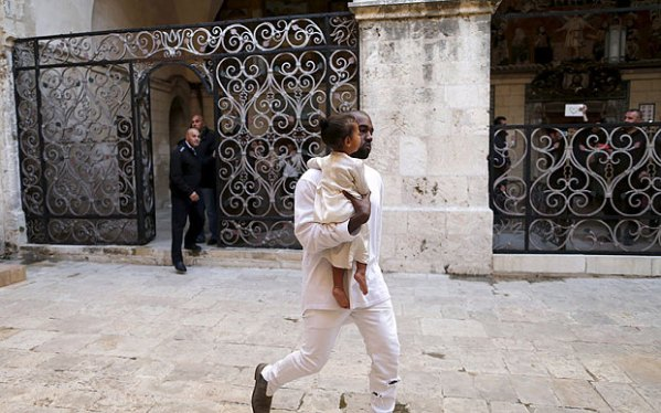 Kanye West with daughter North traveled to Jerusalem in April for the latter's baptism.