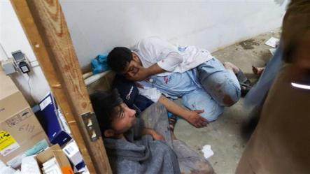 In this photo released by Medecins Sans Frontieres (MSF) on October 3, 2015, Afghan MSF staff are seen in one of the remaining parts of the MSF hospital in Kunduz, northern Afghanistan, after it was hit by a US airstrike. ©AFP