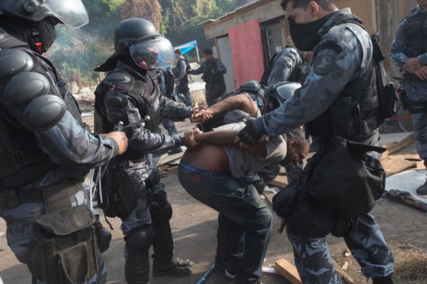Forced evictions from Rio de Janeiro's favelas were carried out by police and army using severe measures and brutal force.